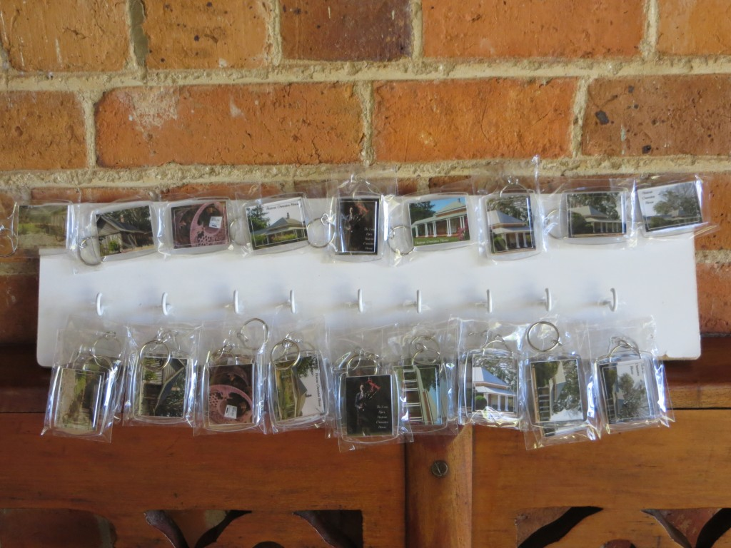 Assorted keyrings displaying Ormiston House, the grounds, sugar machinery, and the Lone Piper. $4 each.